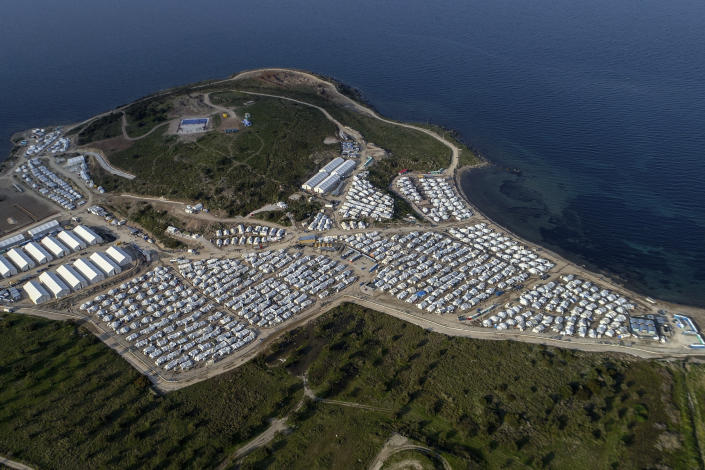 FILE - In this Monday, March 29, 2021 file photo, a general view above Karatepe refugee camp, on the eastern Aegean island of Lesbos, Greece, Monday, March 29, 2021. Greece's notoriously squalid refugee camp of Moria burnt down last September on the island of Lesbos. It left around 12,000 people in need of emergency housing as winter approached. European leaders then vowed such squalid facilities would be a thing of the past. But aid agencies say that a year later the conditions for asylum seekers on the eastern Greek islands have barely improved. (AP Photo/Panagiotis Balaskas, File)