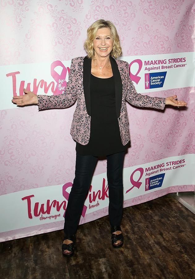 The Aussie actress was diagnosed with breast cancer on the same day her father passed away. Here she is posing at a breast cancer charity event. Photo: Getty