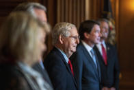 Senate Majority Leader Mitch McConnell of Ky., poses with newly elected Republican senators, from left, Sen.-elect Cynthia Lummis, R-Wyo., Sen.-elect Tommy Tuberville, R-Ala., Sen.-elect Bill Hagerty, R-Tenn., and Sen.-elect Roger Marshall, R-Kan., on Capitol Hill in Washington, Monday, Nov. 9, 2020. (Ken Cedeno/Pool via AP)