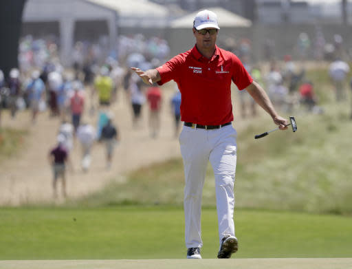 Zach Johnson walks up to the third green during the final round of the U.S. Open Golf Championship, Sunday, June 17, 2018, in Southampton, N.Y. (AP Photo/Julio Cortez)