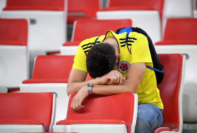 <p>A Colombia fan looks dejected following his sides defeat in the 2018 FIFA World Cup Russia Round of 16 match between Colombia and England at Spartak Stadium on July 3, 2018 in Moscow, Russia. (Photo by Matthias Hangst/Getty Images) </p>