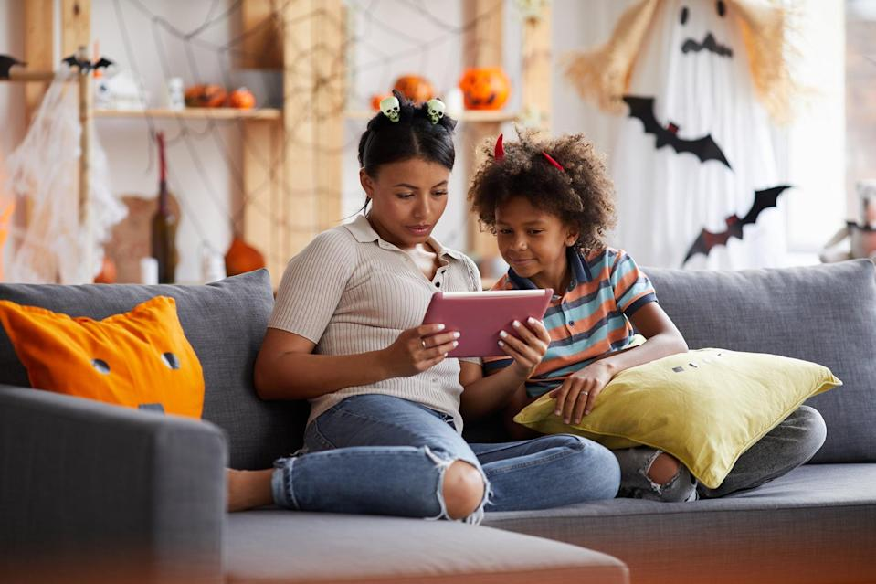 """<p>Invite all of your family's friends for a virtual <a class=""""link rapid-noclick-resp"""" href=""""https://www.popsugar.com/Halloween"""" rel=""""nofollow noopener"""" target=""""_blank"""" data-ylk=""""slk:Halloween"""">Halloween</a> party. Show off costumes, have everyone make a Halloween-themed treat to enjoy """"together,"""" play a fun game, vote for the best costume - there are so many possibilities, and it'll all be fun! You could also do a virtual movie viewing with just a few of your kids' friends in which you start the movie at the same time and let the kids chat through it while on the call.</p>"""