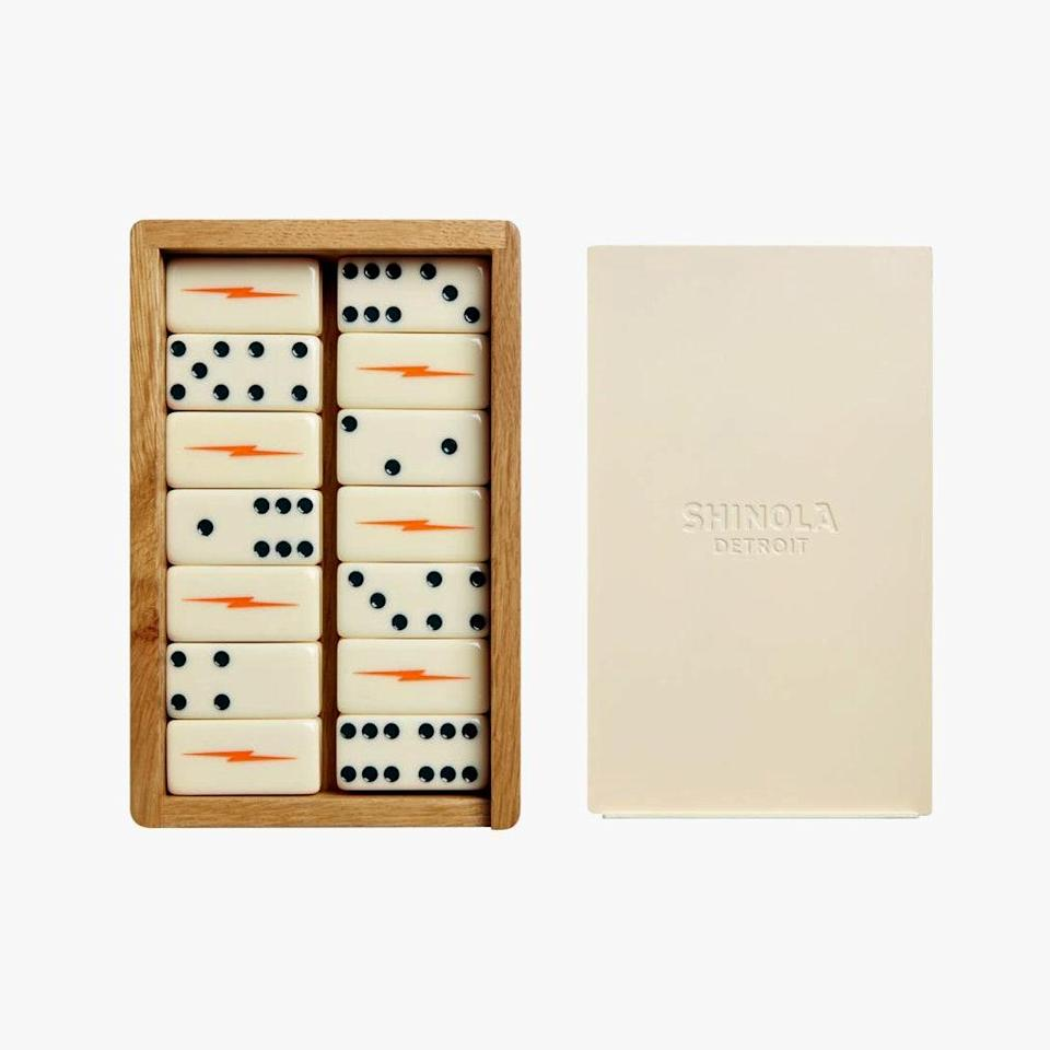 """Yes, Detroit's Shinola hotel sells lots of lovely leather goods, but how fun is this set of dominoes? You'll want to display them after you play them—it's a domino effect. $195, SHINOLA. <a href=""""https://www.shinola.com/collections/the-shinola-hotel/dominoes-set-2020.html"""" rel=""""nofollow noopener"""" target=""""_blank"""" data-ylk=""""slk:Get it now!"""" class=""""link rapid-noclick-resp"""">Get it now!</a>"""