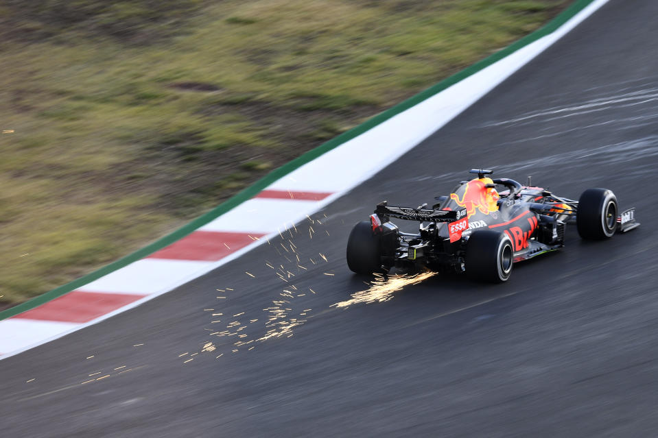 Sparks fly behind Max Verstappen driving the (33) Aston Martin Red Bull Racing RB16 during practice ahead of the F1 Grand Prix of Portugal.