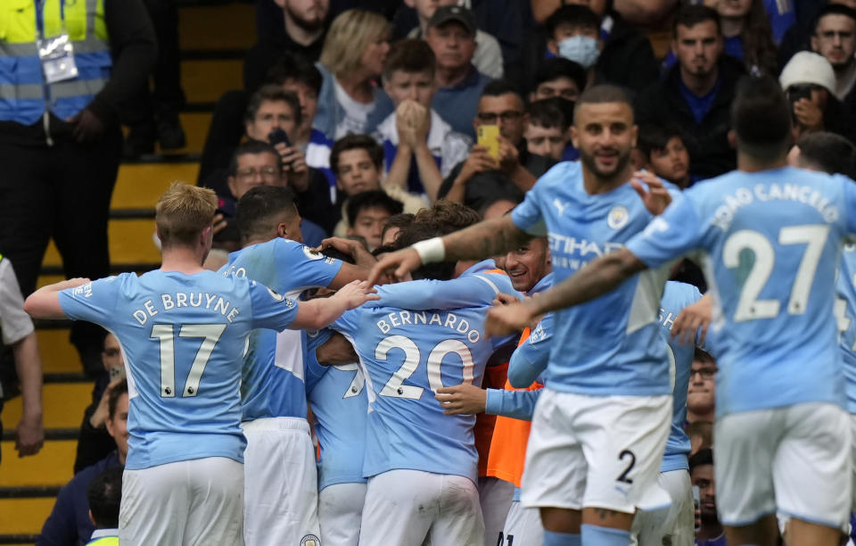 Manchester City's Gabriel Jesus celebrates with teammates after scoring his side's opening goal during the English Premier League soccer match between Chelsea and Manchester City at Stamford Bridge Stadium in London, Saturday, Sept. 25, 2021. (AP Photo/Alastair Grant)