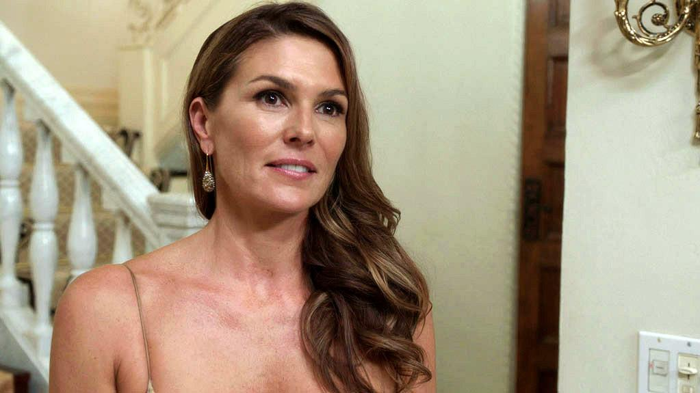 """Paige Turco (""""<a href=""""/nypd-blue/show/160"""">NYPD Blue</a>"""") plays the """"charming, charismatic, and fiercely protective"""" wife of MacLachlan's Raines, Kathleen."""