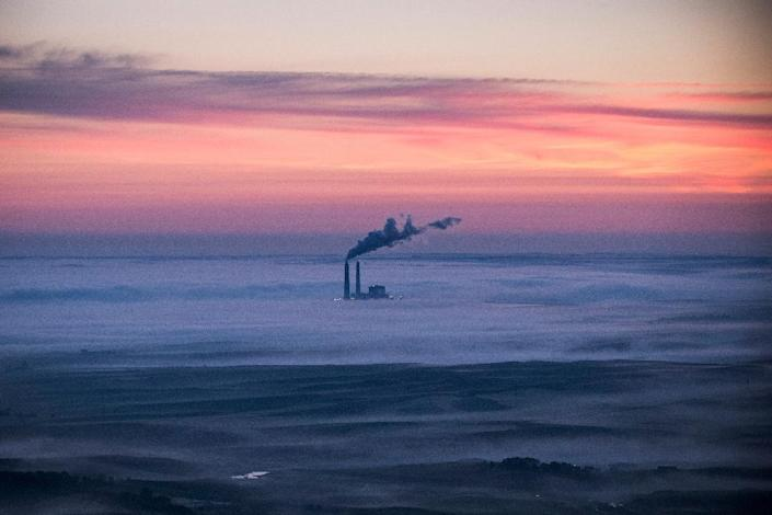 The world's nations are negotiating a new, global pact, which must be inked in Paris in December, to curb climate change through greenhouse gas emission cuts (AFP Photo/Andrew Burton)