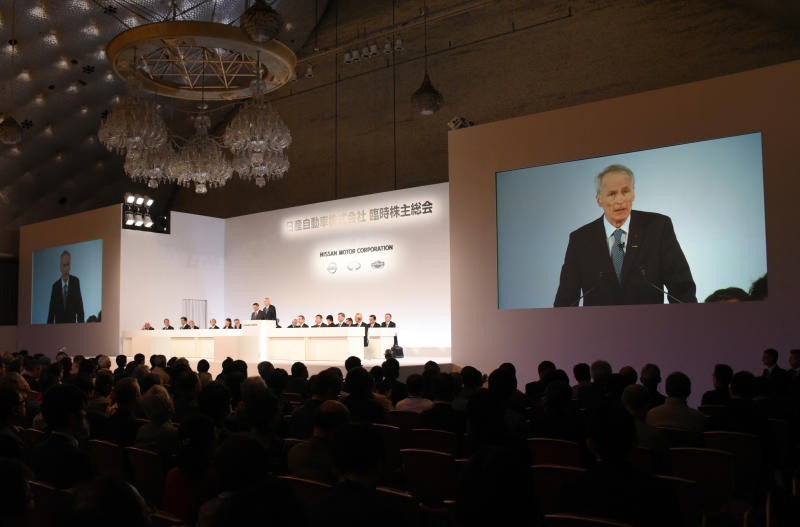 In this photo released by Nissan Motor Co., Renault Chairman Jean-Dominique Senard is seen on screen during the company's shareholders' meeting in Tokyo Monday, April 8, 2019. Nissan shareholders have approved the ouster of former chairman Carlos Ghosn from its board. The approval Monday was shown by applause from the shareholders gathered at a Tokyo hotel. Ahead of the vote, Nissan Chief Executive Hiroto Saikawa apologized for the scandal at the Japanese automaker. Ghosn has been arrested on financial misconduct charges. Shareholders also okayed the appointment of Renault Chairman Senard to replace Ghosn. (Nissan Motor Co. via AP)