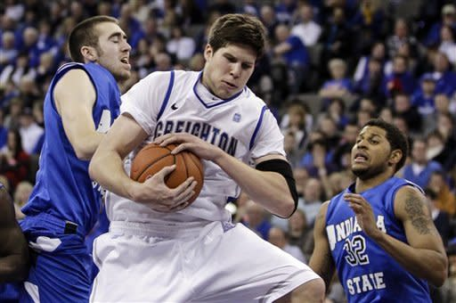 Creighton's Doug McDermott, center, grabs a rebound against Indiana State's Jake Odum, left, and Khristian Smith, right, during the first half of an NCAA college basketball game in Omaha, Neb., Saturday, Jan. 5, 2013. (AP Photo/Nati Harnik)