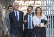 Members of Carlos Ghosn's defense team, lawyer Jean Yves Le Borgne, second left, Carlos Abou Jaoude, second right, and Jean Tamalet, left, leave the Justice Palace in Beirut, Lebanon, Friday, June 4, 2021. Ghosn was arrested in Japan in November 2018 on accusations of financial misconduct and was kept in solitary confinement for months without being allowed to speak with his wife. He fled to Lebanon a year later in a Hollywood-style escape that stunned the world. (AP Photo/Hassan Ammar)