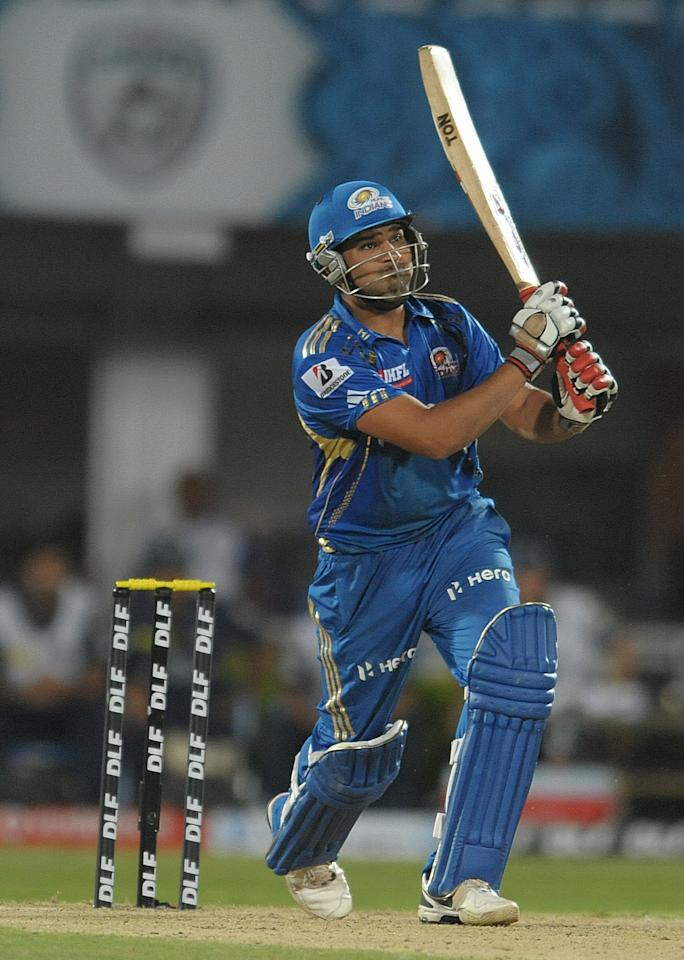 Mumbai Indians batsman Rohit Sharma play a winning shot on April 9, 2012 during the IPL Twenty20 cricket match against the Deccan Chargers at the Dr. Y.S. Rajasekhara Reddy Cricket Stadium in Visakhapatnam.                            AFP PHOTO / NOAH SEELAM RESTRICTED TO EDITORIAL USE. MOBILE USE WITHIN NEWS PACKAGE (Photo credit should read NOAH SEELAM/AFP/Getty Images)