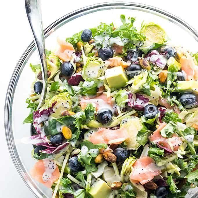 """<strong>Get the <a href=""""https://www.wholesomeyum.com/recipes/salmon-kale-superfood-salad-recipe-with-lemon-vinaigrette/"""" target=""""_blank"""" rel=""""noopener noreferrer"""">Salmon Kale Superfood Salad With Creamy Lemon Vinaigrette</a> recipe from Wholesome Yum.</strong>"""