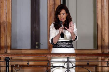 Argentina's President Fernandez speaks to supporters from a balcony inside the Casa Rosada Presidential Palace in Buenos Aires