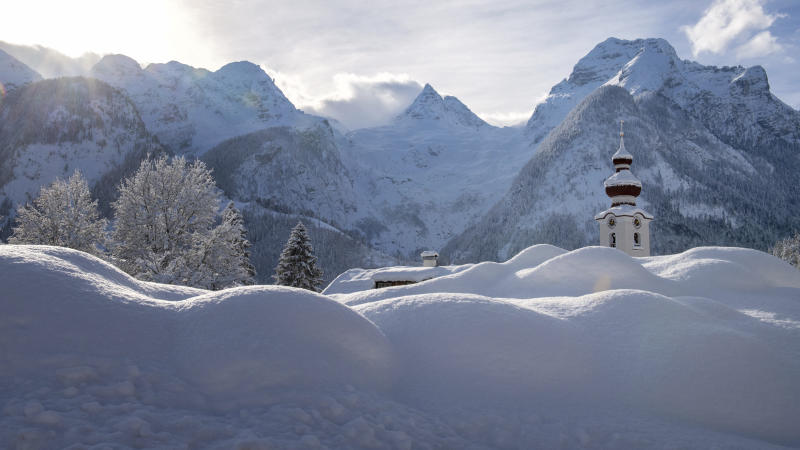 The steeple of the Loferer church is seen through the snow in Lofer, Austrian province of Salzburg on Friday, Jan. 11, 2019 after a heavy snowfall. (AP Photo/Kerstin Joensson)