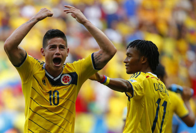 Colombia's James Rodriguez (L) celebrates next to teammate Juan Cuadrado scoring against Ivory Coast during their 2014 World Cup, June 19, 2014. (REUTERS/Paul Hanna)