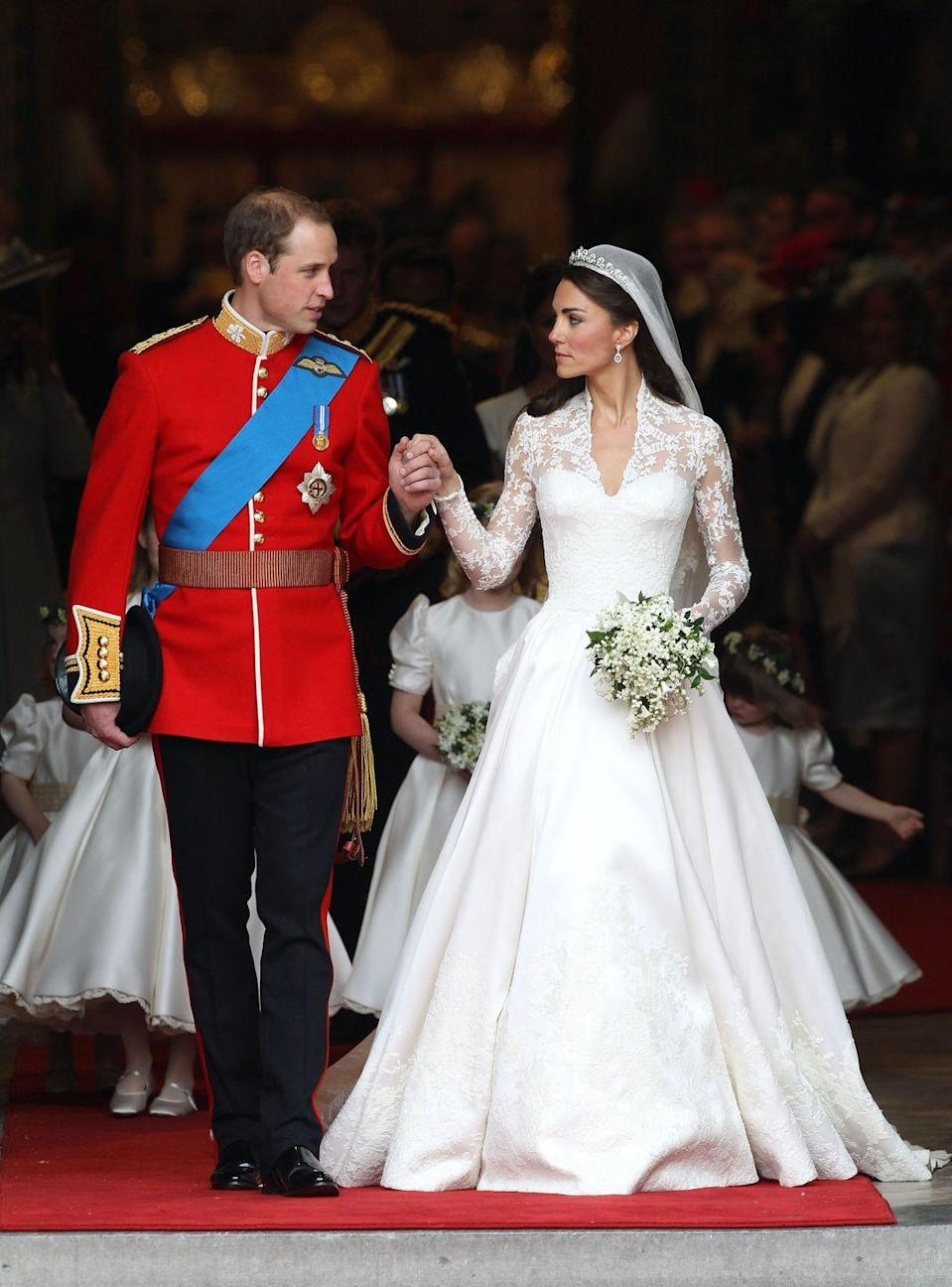 "<p>For Prince William and Kate Middleton's massive wedding at Westminster Abbey, Kate pulled out all of the stops for her dress. Her Alexander McQueen gown featured 58 gazar and organza covered buttons down the back and she borrowed the <a href=""https://www.townandcountrymag.com/the-scene/weddings/g17805394/royal-wedding-tiaras-throughout-history/"" rel=""nofollow noopener"" target=""_blank"" data-ylk=""slk:Queen's Cartier Halo"" class=""link rapid-noclick-resp"">Queen's Cartier Halo</a>, which was given to Queen Elizabeth by the Queen Mother on her 18th birthday.</p>"