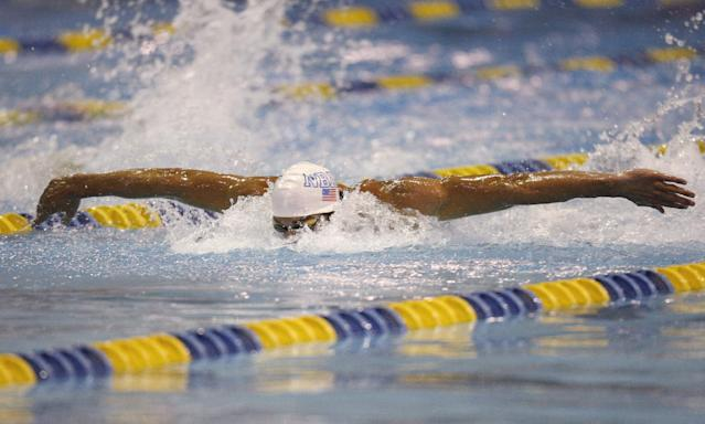 Michael Phelps swims on the way to winning the 100-meter butterfly in the Arena Grand Prix swim meet in Charlotte, N.C., Friday, May 16, 2014. (AP Photo/Nell Redmond)