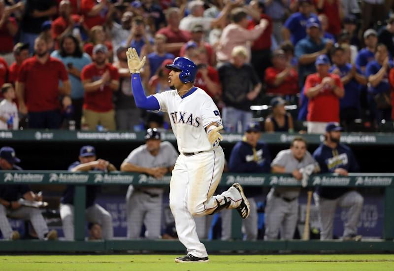 Carlos Gomez will be back in a Rangers uniform for 2017. (AP)