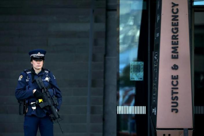 An armed police officer stands guard outside the Christchurch High Court during the sentencing hearing for Brenton Tarrant, the gunman who killed 51 people at two New Zealand mosques last year