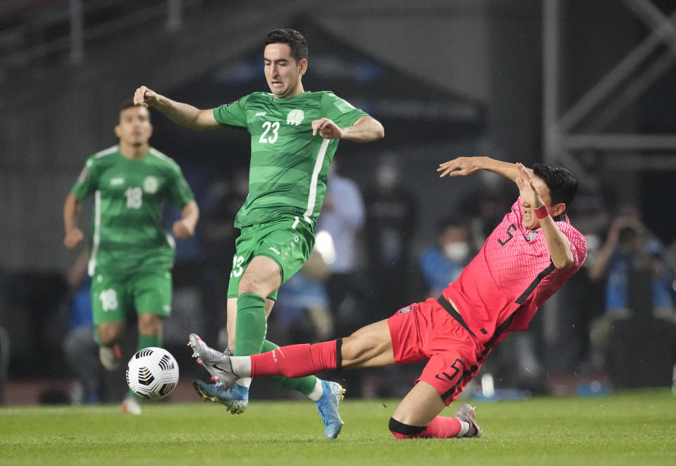South Korea's Jung Woo-young, right, fights for the ball against Turkmenistan's Velmyrat Ballakov during their Asian zone Group H qualifying soccer match for the FIFA World Cup Qatar 2022 at Goyang stadium in Goyang, South Korea, Saturday, June 5, 2021. (AP Photo/Lee Jin-man)