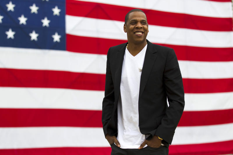 """FILE - In this May 14, 2012 file photo, entertainer Shawn """"Jay-Z"""" Carter smiles in between interviews, after a news conference at Philadelphia Museum of Art in Philadelphia. Pearl Jam, Skrillex, D'Angelo and more performers will take the stage at the Jay-Z-curated """"Budweiser Made in America"""" music festival in Philadelphia this September. The festival will feature 28 acts at Philadelphia's Fairmount Park on Sept 1. and Sept. 2, which is Labor Day weekend. Tickets for the two-day festival go on sale Wednesday. (AP Photo/Matt Rourke, file)"""