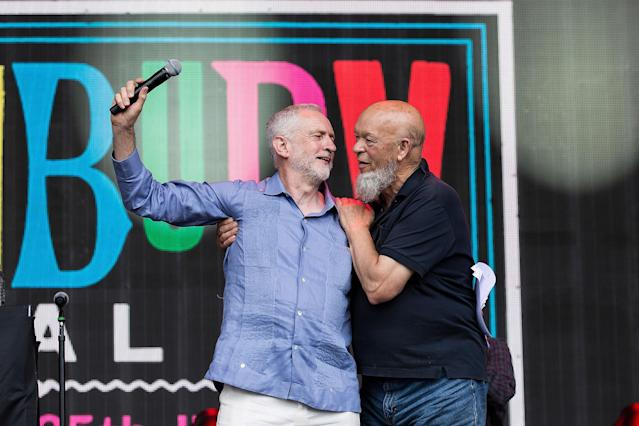 <p>Labour leader Jeremy Corbyn, left, and organizer Michael Eavis onstage at the Glastonbury Festival at Worthy Farm, in Somerset, England, Saturday, June 24, 2017. (Photo: Grant Pollard/Invision/AP) </p>