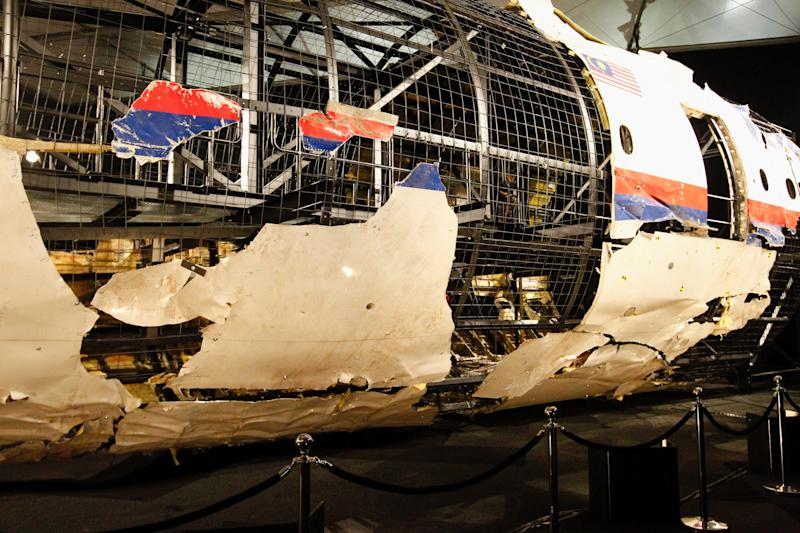 GILZE-RIJEN AIR BASE, Oct. 13, 2015-- Wreckage of flight MH17 is seen after the presentation of the investigation report on the cause of its crash, at the Gilze-Rijen air base, the Netherlands, on Oct. 13, 2015. The crash of flight MH17 on 17 July last year was caused by the detonation of a 9N314M-type warhead launched from eastern Ukraine using a Buk missile system, said the investigation report published Tuesday by the Dutch Safety Board (DSB). (Xinhua/Sylvia Lederer via Getty Images)