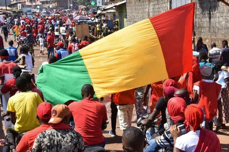 Demonstrators take part in a protest against the third term of Guinean President Alpha Conde, in Conakry, on November 26