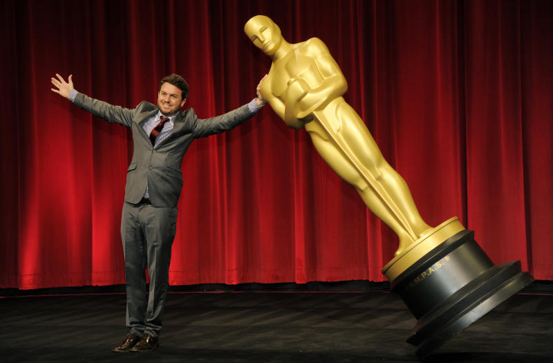 """Filmmaker Brian Schwarz of the University of Texas at Austin, a nominee in the Narrative Category for his film """"Ol' Daddy,"""" poses with an Oscar statue before the Academy of Motion Picture Arts and Sciences 40th Student Academy Awards at the Samuel Goldwyn Theater on Saturday, June 8, 2013 in Beverly Hills, Calif. (Photo by Chris Pizzello/Invision/AP)"""