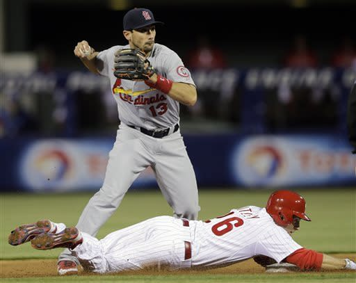 Philadelphia Phillies' Chase Utley, bottom, breaks up the throw by St. Louis Cardinals' Matt Carpenter after being forced out at second base on a fielder's choice by Michael Young during the second inning of a baseball game on Friday, April 19, 2013, in Philadelphia. Young was safe at first. (AP Photo/Matt Slocum)