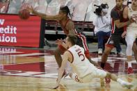 Wisconsin's Tyler Wahl and Ohio State's Eugene Brown III go after a loose ball during the second half of an NCAA college basketball game Saturday, Jan. 23, 2021, in Madison, Wis. (AP Photo/Morry Gash)