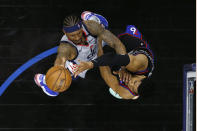 Washington Wizards' Bradley Beal, left, goes up for a shot against Philadelphia 76ers' Tobias Harris during the second half of Game 1 of a first-round NBA basketball playoff series, Sunday, May 23, 2021, in Philadelphia. (AP Photo/Matt Slocum)