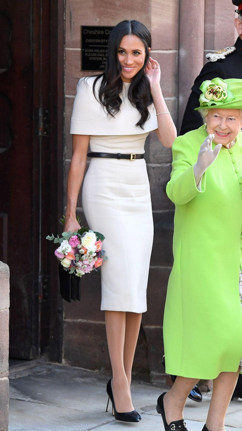 """<p>The Duchess went for a <a href=""""https://www.net-a-porter.com/gb/en/Shop/Designers/Givenchy?pn=1&npp=60&image_view=product&dScroll=0"""" rel=""""nofollow noopener"""" target=""""_blank"""" data-ylk=""""slk:Givenchy"""" class=""""link rapid-noclick-resp"""">Givenchy</a> dress, complete with removable cape, to visit Cheshire with the Queen.</p>"""