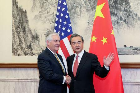 Chinese Foreign Minister Wang Yi shakes hands with U.S. Secretary of State Rex Tillerson at Diaoyutai State Guesthouse in Beijing