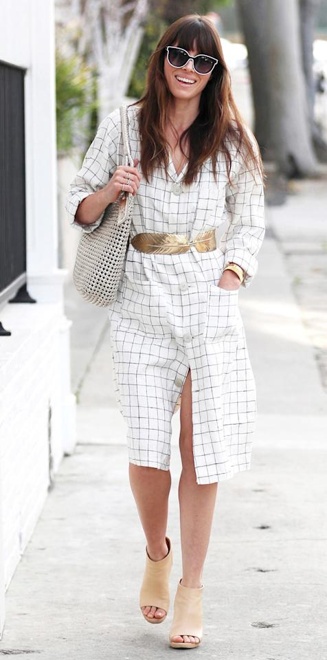 "<p>Biel stepped out in sunny Los Angeles rocking a palette of neutrals like the street style star she is. Sheathed in a white check shirt dress, a gilded belt designed to resemble a feather, and a pair of beige peep toe booties (shop similar boots <a rel=""nofollow"" href=""https://click.linksynergy.com/fs-bin/click?id=93xLBvPhAeE&subid=0&offerid=255436.1&type=10&tmpid=10034&RD_PARM1=https%253A%252F%252Fwww.farfetch.com%252Fshopping%252Fwomen%252Fgivenchy--shark-lock-booties-item-11429759.aspx%253Ffsb%253D1%2526storeid%253D9462%2526size%253D29%2526utm_source%253Dpolyvore.com%2526utm_medium%253Daffiliate%2526utm_campaign%253DRARUS_desktop&u1=ISJessicaBielBootiesIJMarch"">here</a>), the actress as looked radiant as ever.</p>"