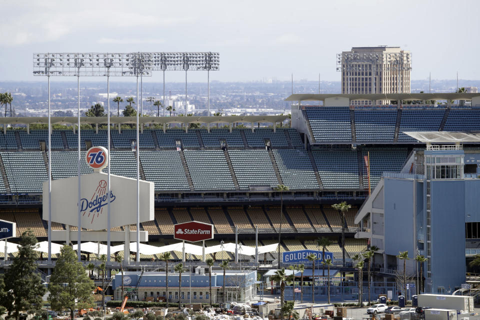 FILE - This March 25, 2020, file photo shows the exterior of Dodgers Stadium, home of the Los Angeles Dodgers baseball team, in Los Angeles. Voting will look a little different this November. In Los Angeles, Dodger Stadium will be used as a vote center and NBA owners have pledged to open arenas in Salt Lake City and elsewhere as part of an agreement they made with players to combat racial injustice. (AP Photo/Marcio Jose Sanchez, File)