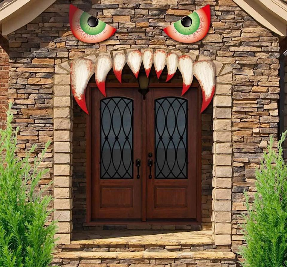 <p>This <span>Jollylife Halloween Decoration Garage Door Archway Monster Face</span> ($9) is such a clever idea.</p>