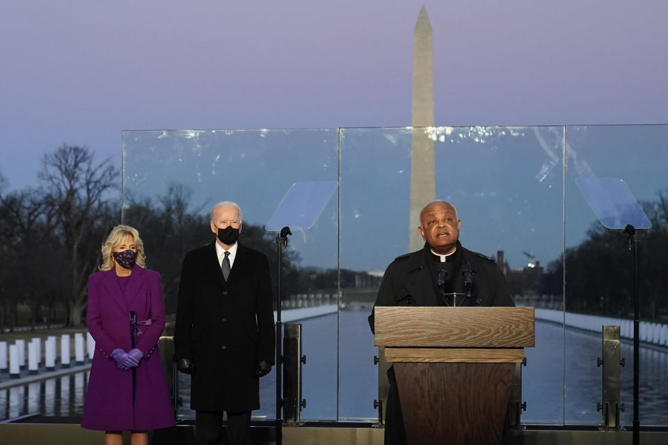 FILE - In this Tuesday, Jan. 19, 2021 file photo, President-elect Joe Biden and his wife, Jill, listen as Cardinal Wilton Gregory, Archbishop of Washington, delivers the invocation during a COVID-19 memorial at the Lincoln Memorial Reflecting Pool in Washington. Gregory has made clear that President Biden, who sometimes worships in Washington, is welcome to receive Communion at the archdiocese's churches. (AP Photo/Alex Brandon, File)