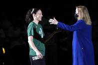 Seattle Storm's Sue Bird, left, is greeted by WNBA commissioner Cathy Engelbert during a championship ring ceremony before a WNBA basketball game against the Las Vegas Aces, Saturday, May 15, 2021, in Everett, Wash. (AP Photo/Elaine Thompson)