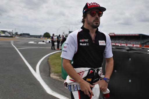 Driver of the Toyota TS050 Hybrid No8, Fernando Alonso of Spain, walks on the track prior to the start of the 86th 24-hour Le Mans endurance race, in Le Mans, western France, Saturday, June 16, 2018. (AP Photo/Thibault Camus)