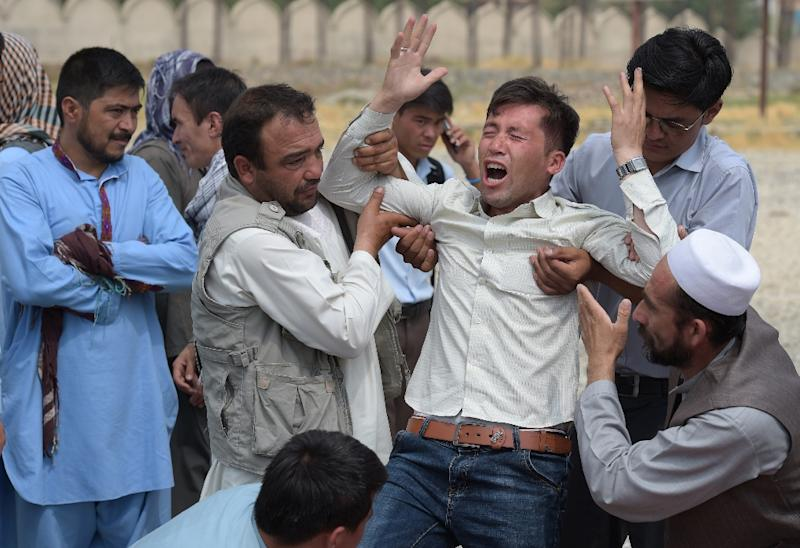 A man at a mosque in Kabul on July 24, 2016, grieves the death of a relative after the IS group claimed responsibility for twin explosions the day before that ripped through crowds of Shiite Hazaras in the Afghan capital killing at least 80 people (AFP Photo/Shah Marai)