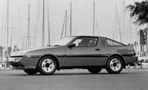 """<p>While other countries received the car with Mitsubishi's legendary 4G63, our version was available only with the 2.6-liter Astron engine, a large-displacement four-banger with a turbo strapped to it. Porsche licensed Mitsubishi's """"Silent Shaft"""" balance-shaft tech for its own big four, used in the 944 and the 968. Upon inspection, the styling seems influenced by the Renault Alpine A310, which was no bad thing. It featured the de rigueur pop-up headlamps of the era, and later ESi-R variants bulked up with some beefy fender flares. The company attempted to homologate the Starion for Group B rallying, and although the FIA approved it for competition, the series went away before the car had its shot at glory. </p>"""