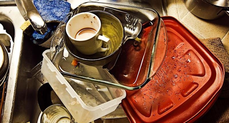 Sink full of dishes shown as households are warned not to use sponges in their kitchen.