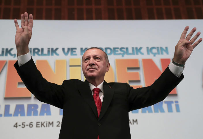 Turkey's President Recep Tayyip Erdogan, waves to supporters during an event in Ankara, Turkey, Saturday, Oct. 5, 2019. Turkey's president threatened Saturday to launch a solo military operation into northeastern Syria, where U.S. troops are deployed and have been trying to defuse tension between its NATO ally and Syrian Kurdish forces. (Presidential Press Service via AP, Pool)