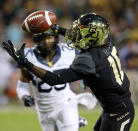 Baylor wide receiver Tevin Reese (16) pulls down a pass for a touchdown over West Virginia safety Darwin Cook (25) during the first half of an NCAA college football game on Saturday, Oct. 5, 2013, in Waco, Texas. (AP Photo/Jose Yau)