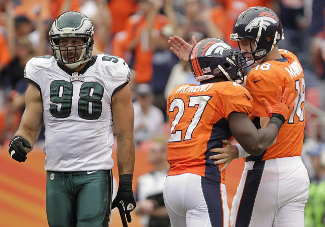 Denver Broncos quarterback Peyton Manning (18) and running back Knowshon Moreno (27) greet each other on the field after a touchdown against the Philadelphia Eagles in the third quarter of an NFL football game, Sunday, Sept. 29, 2013, in Denver. (AP Photo/Joe Mahoney)