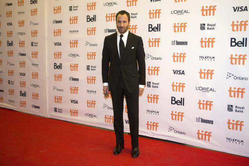 Director Tom Ford arrives on the red carpet for the film 'Nocturnal Animals' during the 2016 Toronto International Film Festival in Toronto on Sunday, Sept. 11, 2016. (Chris Young/The Canadian Press via AP)