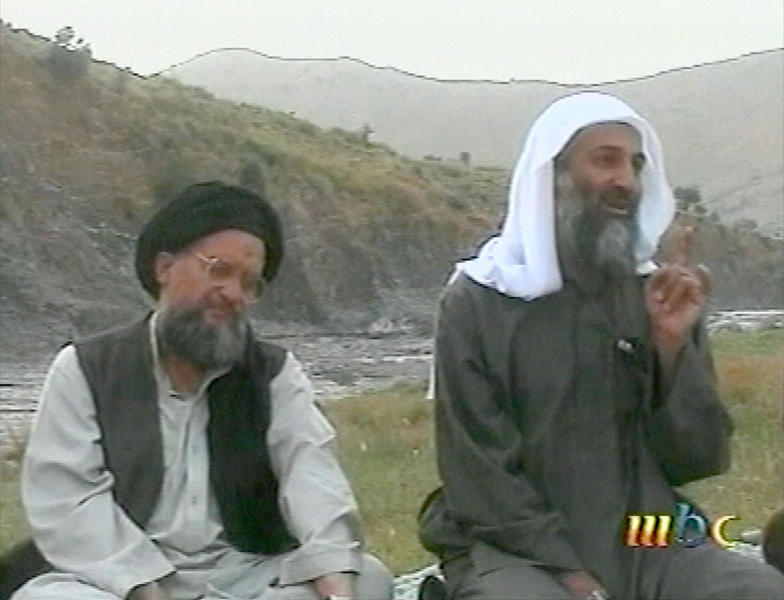 FILE - This file image broadcast April 17, 2002, by the London based Middle East Broacasting Corp, shows Osama bin Laden, right, and top deputy Ayman Al-Zawahri in an unknown location. Although the Taliban had promised Washington during months of negotiations that the U.S. will never again be attacked from Afghan soil, there's no evidence of a break in relations between long-time allies the Taliban and al-Qaida. After the collapse of the Taliban deal in September 2019, it's not clear if the Taliban gave Washington any information on where al-Qaida leaders, including Osama bin Laden's successor, al-Zawahri, are hiding. (MBC via AP, File)