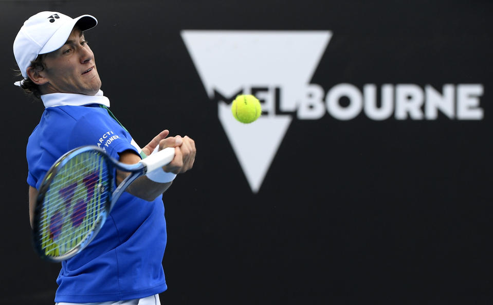 Norway's Casper Ruud hits a forehand return to Moldova's Radu Albot during their third round match at the Australian Open tennis championship in Melbourne, Australia, Saturday, Feb. 13, 2021.(AP Photo/Andy Brownbill)