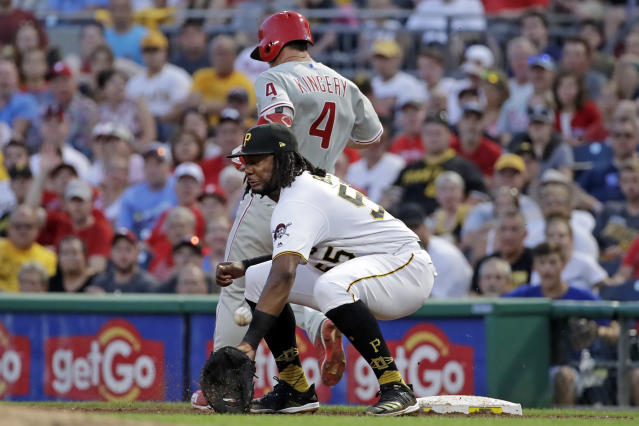 Pittsburgh Pirates first baseman Josh Bell (55) cannot handle the throw from third baseman Colin Moran as Philadelphia Phillies' Scott Kingery (4) reaches first with a single off Pirates starting pitcher Jordan Lyles during the fifth inning of a baseball game in Pittsburgh, Friday, July 19, 2019. (AP Photo/Gene J. Puskar)